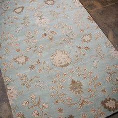 Wool rug with a blue floral motif.   Product: RugConstruction Material: 100% WoolColor: BlueFeatures:  Plush pileDurableNote: Please be aware that actual colors may vary from those shown on your screen. Accent rugs may also not show the entire pattern that the corresponding area rugs have.Cleaning and Care: Vacuum regularly. If spills occur, blot immediately with cold water. Avoid direct sunlight to prevent fading. Professional cleaning is recommended.