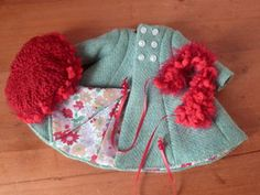 Tuto manteau (Tuto Coat)  on this site is a pattern for a smocked dress.  There is also a pattern for a cute hat.