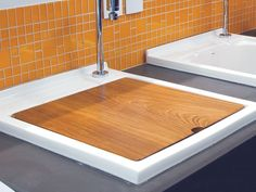 Wood cover for the laundry sink to create more folding area