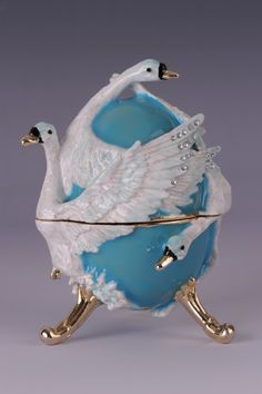 Turquoise swan Faberge Easter Egg with pedant inside by Keren Kopal Swarovski - Each item is made of pewter & either 24K Gold or 925 silver plated. The entire process, from the first sketch to the final product, is made by hand of talented and skilled artisans under the supervision of the artist Keren Kopal