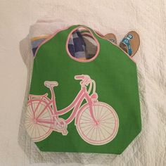 Mudpie Bicycle Beach Bag This bag is beach or pool ready! Tons of room inside for multiple towels, books or pool toys. Fun pink and green color with bicycle design. Handle allows the bag to be carried on your shoulder or in hand. Made of canvas. Never used, great condition. Bags Totes