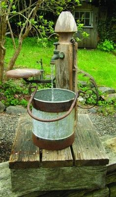 made from a table leg, a rusty bucket and iron remnants, probably from an old buggy