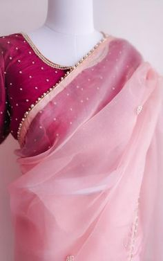 Featuring this beautiful Light Pink saree in Organza base with hand embroidered pearl work bootis all over. It is paired with a Plain wine colour Dupion blouse with Pearl Work on Front, back and sleeves. Pink Saree Blouse, Silk Saree Blouse Designs, Saree Blouse Patterns, Sari Dress, Stylish Sarees, Stylish Dresses, Saris Indios, Woman Clothing, Indian