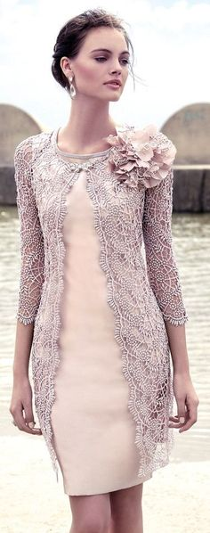 Carla Ruiz: lace smock, sleeveless dress.
