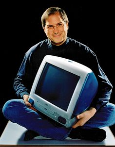 Jobs with the original iMac, 1998. Mine was teal.    I wanted this so bad!  I like the one I have now better.  :)