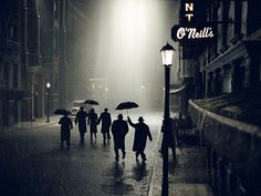 the iconic scene with silhouettes in the rain, stuck in a dead-end street - from Road To Perdition
