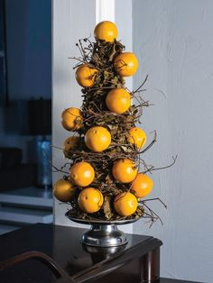 Grapevine and clementines make a centerpiece that will get you past Thanksgiving --> http://www.hgtvgardens.com/crafts/a-homemade-thanksgiving-centerpiece?soc=pinterest