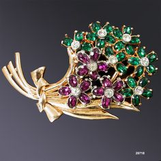 Vintage Purple & Green Corsage Brooch by AntiquingOnLine, $75.00 at https://www.etsy.com/listing/96034718/vintage-flower-pin-brooch-purple-green