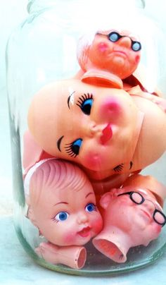 Kitschy and creepy vintage doll faces. What's not to love?!