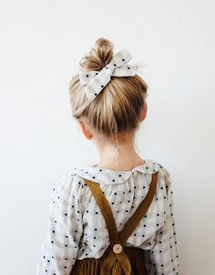 white and black polkadot blouse with olive green jumper makes for a cute little girl outfit