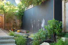 The children's play area in this Vancouver yard offers a chalkboard wall complete with holes for optional rock climbing holds...
