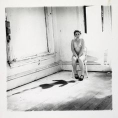 Woodman perches naked on a chair, appearing defensive and vulnerable. This is one of the few self-portraits where we see the artist's full face. The vague black body imprinted on the floor seems to walk through the ground, as if descending into a nether world, while the desolate setting creates a chilling atmosphere. This is one of a series of photographs displaying the influence of Surrealism in the way it explores the supernatural. Woodman usually puts herself in the frame, although these…