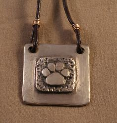 Hey, I found this really awesome Etsy listing at https://www.etsy.com/listing/78648503/layered-paw-square-necklace-in-bronze