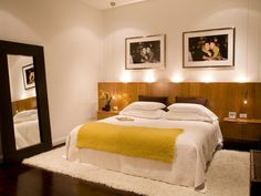 Browns and Wood. White and mustard. Modern bedroom with oversized mirror. #lovely !