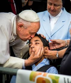 Pope Francis kisses Michael Keating, a 10-year-old boy who suffers from cerebral palsy, after arriving in Philadelphia on Sept. 26, 2015.