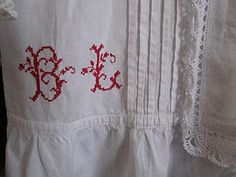 Monogram made by cross stitches