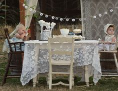 Ignoring the babies... If lace is an option for the tables then that would look amazing over top of a darker table cloth cover.