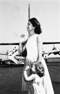 Love this photo (Jackie pregnant with John Jr.) and Caroline, perhaps waving hello or goodbye to Jack.  <3
