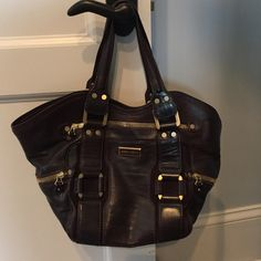 Jimmy Choo Purse Bag Nice thick brown leather with tons of gold zippers and accents. Lots of pockets inside and out. Great condition!! Jimmy Choo Bags