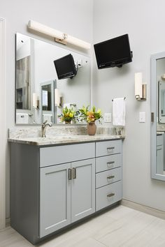 "Gorgeous Sequoia marble countertops complement the custom his & her vanities painted in Benjamin Moore's Boothbay Gray. Minka ""Square"" vanity fixture and sconce brighten up this space with soft light. Home Renovation, Home Remodeling, Modern Bathroom, Bathroom Ideas, Marble Countertops, Building Design, Design Projects, Creative Design, Home Improvement"