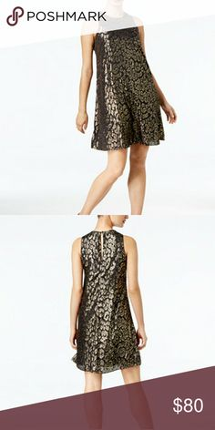 Calvin Klein Foil Print Dress PRODUCT DETAILS  Look fancy and sassy in this free-flowing dress from Calvin Klein, featuring an all over foiled pattern and lightly lined construction.  Nylon Sleeveless Scoop neck Knee length Foiled pattern Imported Calvin Klein Dresses Midi