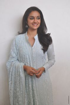 Keerthy Suresh Stills at Mahanati Film Interview. Keerthy Suresh donned a pastel blue chikankari palazzo suit which she styled it with a pair of silver oxidized jhumkis and silver kolhapuri chappals. Palazzo Suit, Artists For Kids, Malayalam Actress, Beautiful Bollywood Actress, Bindi, South Indian Actress, Pastel Blue, S Pic, Shades Of Grey