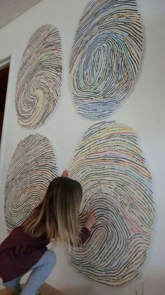 I WANT THIS!!!! Thumbprint portraits use your child's own thumbprint to create a large (three feet high!), colorful work of art that he or she will absolutely love.