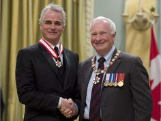 Governor General David Johnston invests actor and director Paul Gross as an Officer of the Order of Canada during a ceremony at Rideau Hall in Ottawa on Friday, February