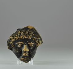 Greek terracotta head fragment, 4th century B.C. Greek black ware pottery head of man with curly hairs, probably from a vase, 6.7 cm high. Private collection