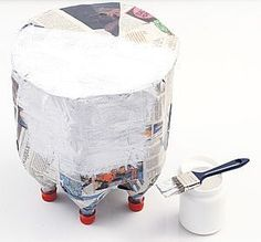 Create table or stool out of recycled bottles