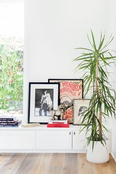 Leaning framed art allows more flexibility for change than mounting it on the wall; Source: My Domaine