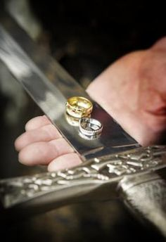 Like this idea....'because of the warrior nature of our clan, the rings were traditionally offered by sword blade.'