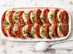Get Roasted Tomato Caprese Salad Recipe from Food Network, take to Italy trip meeting! Get Roasted Tomato Caprese Salad Recipe from Food Network, take to Italy trip meeting! Caprese Salat, Tomato Caprese, Caprese Salad Recipe, Tomato Pie, Tomato Mozzarella, Tomato Recipe, Food Network Recipes, Cooking Recipes, Healthy Recipes