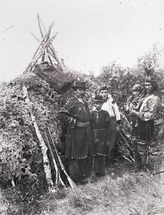L-R: Issac Sack, unknown, unknown, Israel Knockwood holding unidentified child - Mi'kmaq - circa 1890