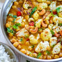 Chickpea Cauliflower Curry - Vegan, healthy 20 minute curry with chickpeas and cauliflower simmered in coconut-curry broth.