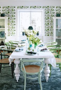 The varied shades of green chairs are so lovely around this long dining table. Love the table, ADORE the chairs--I think I need to do this!!