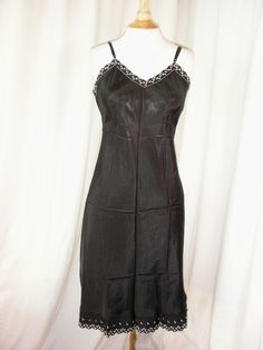 1950s slip in heavy satin like fabric with embroidered accents