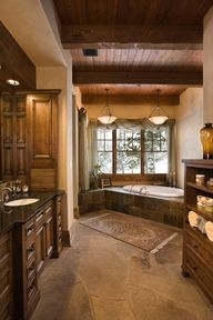 Warm inviting bathroom- likes the colors and the natural elements- wood, slate
