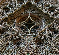 Eric Standley's work is made out of hundreds (yes hundreds!) of sheets of paper that are laser cut with dense geometric patterns.