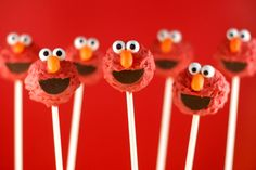 Elmo Cake Pops by Bakerella, PAIN IN THE ASS... made these for my boyfriend's nephew's 1st birthday... red velvet cake with cream cheese on the inside... and bakerella is right... texturizing the fur is a pain in the ass !!!