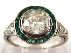 An Art Deco emerald and diamond ring, sold for £2,800.