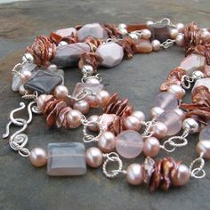 Mauvelous botswana agate, keshi freshwater pearls, pink chalcedony, long hand wired necklace  $92.00