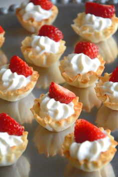 {5 Ingredient} Strawberries and Cream Tarts   A guilt free, no bake dessert with vanilla greek yogurt custard, phyllo cups & strawberries!