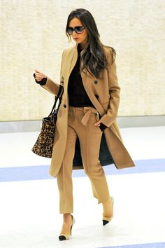 Victoria Beckham landed in New York in impeccable style — because what else would we expect from the artist formerly known as Posh? The British designer made her way through the terminal in a camel coat and leopard-print tote from her own line and Nicholas Kirkwood pumps.