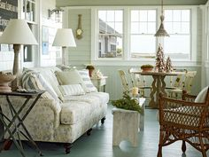 What a space!  Kick back on this cozy, coastal porch. An overstuffed sofa in a durable fabric makes this space an easy transition from beach to bedroom. (Photo: Tria Giovan)