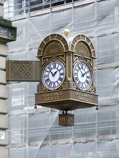 One of a pair of four sided ornate clocks on the Scottish Legal Life Assurance building on Bothwell Street, Glasgow.