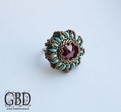 Great photo tutorial for this beautiful ring! (in russian, but the pictures are easy to folow!)