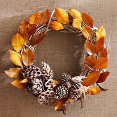 Leaves and Pinecones Fall Wreath - Wire dried artichokes, lotus pods, and pinecones to the bottom of a grapevine wreath. Tuck brown and gold leaves between the wreath's twigs, securing with hot glue if needed. Diy Fall Wreath, Autumn Wreaths, Holiday Wreaths, Wreath Ideas, Thanksgiving Wreaths, Thanksgiving Decorations, Seasonal Decor, Deco Originale, How To Make Wreaths