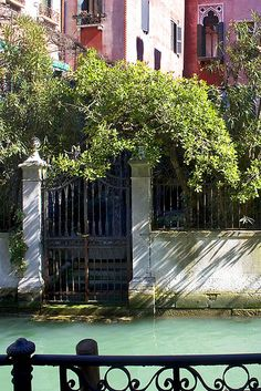 Garden Gate and Courtyard along the Canal by Rita Crane Photography / Venice Italy