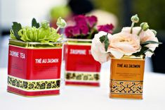 florals in vintage tea cans  Photography by bandgphotography.com, Floral Design by artisanevents.net